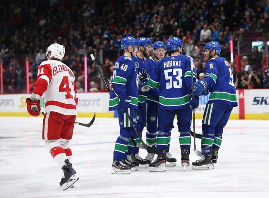 Vancouver Canucks' Alexander Edler, second from left at rear, celebrates his goal with teammates Elias Pettersson (40), Brock Boeser (6), Bo Horvat (53) and J.T Miller (9) during the second period.