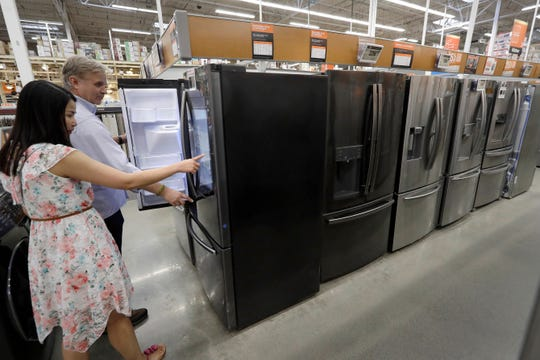 Shoppers examine refrigerators at a Home Depot store location, in Boston.