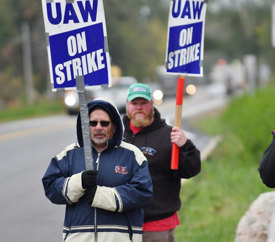 Mike Culley, foreground, at the GM Romulus Powertrain plant, said Wednesday he just wants to get back to work and hopes that the UAW got a good deal.