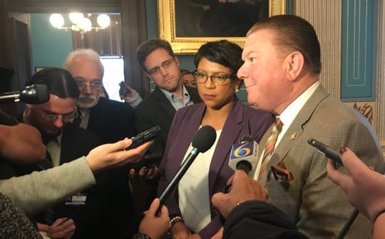 Sen. Sylvia Santana, D-Detroit, and Sen. Peter Lucido, R-Shelby Twp., discuss votes to begin treating 17-year-olds as juveniles in the criminal justice system on Wednesday, Oct. 16, 2019.