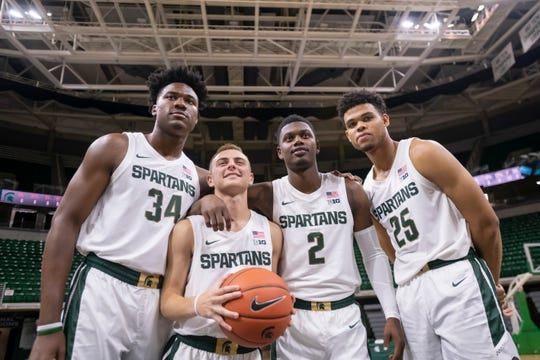 From left: Michigan State freshman players Julius Marble, Steven Izzo, Rocket Watts, and Malik Hall pose for a portrait while participating in the basketball team's media day at the Breslin Center in East Lansing.