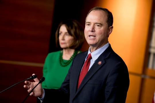 Rep. Adam Schiff, D-Calif., Chairman of the House Intelligence Committee, right, accompanied by House Speaker Nancy Pelosi of Calif., left, speaks about the House impeachment inquiry into President Donald Trump at a news conference on Capitol Hill in Washington, Tuesday, Oct. 15, 2019.