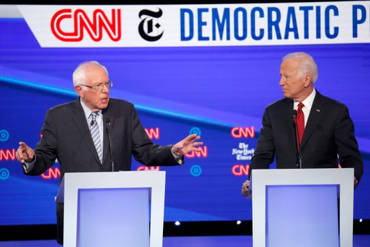 Democratic presidential candidate Sen. Bernie Sanders, I-Vt., left, and former Vice President Joe Biden participate in a Democratic presidential primary debate hosted by CNN/New York Times at Otterbein University, Tuesday, Oct. 15, 2019, in Westerville, Ohio.