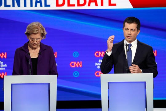 Democratic presidential candidate Sen. Elizabeth Warren, D-Mass., left, and South Bend Mayor Pete Buttigieg participate in a Democratic presidential primary debate hosted by CNN and The New York Times at Otterbein University, Tuesday, Oct. 15, 2019, in Westerville, Ohio.
