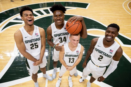 From left: Freshman players Malik Hall, Julius Marble, Steven Izzo (ball on his head) and Rocket Watts goof around while posing for a portrait while participating in Michigan State's media day at the Breslin Center in East Lansing.