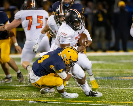 Christian Dhue-Reid (1) and Belleville will put their perfect record on the line when they visit Livonia Franklin on Friday.
