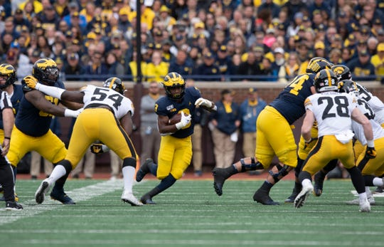 Running back Christian Turner, middle, has been a part of a Michigan ground attack that has racked up 560 rushing yards over the last three games.
