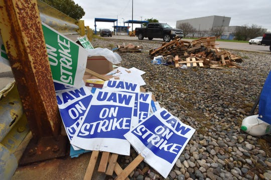 'UAW On Strike' picket signs are stacked up in a pile at the GM Warren Transmission Operations plant before striking UAW members hear there may be a tentative deal.