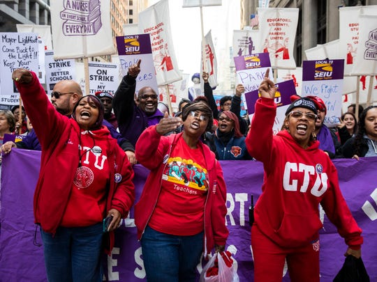 Members of the Chicago Teachers Union and SEIU Local 73 march through the Loop after a rally Monday. Chicago's public schools have canceled classes after the teachers' union president announced that his bargaining team will recommend teachers vote to go on strike.