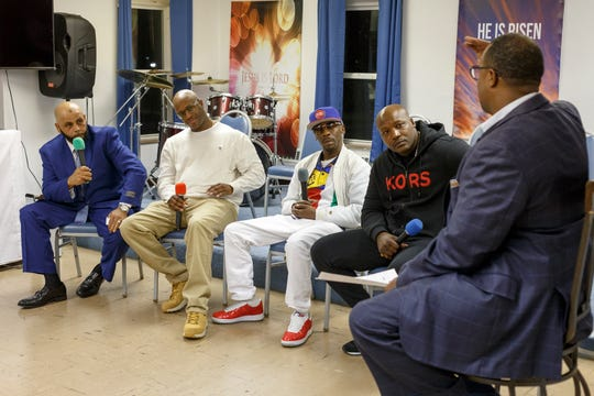 From left, Mubarez Ahmed, Justly Johnson, Michael Powels, and Aaron Salter -- all wrongfully convicted and exonerated -- talk about their experiences with Pastor Terrence Devezin and others during a Welcome Home ceremony Tuesday at the United Kingdom Church located inside the Trinity Presbyterian Church in Detroit.