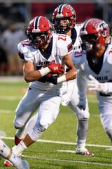 James Carpenter (22) and Livonia Franklin play host to Belleville this week.