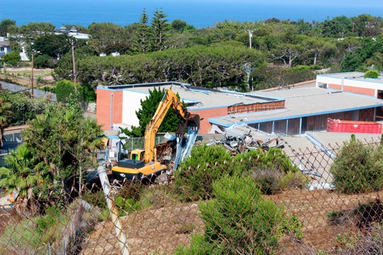 This July 5, 2017, image provided by Malibu Surfside News shows the demolition of the former Malibu Middle School in California.