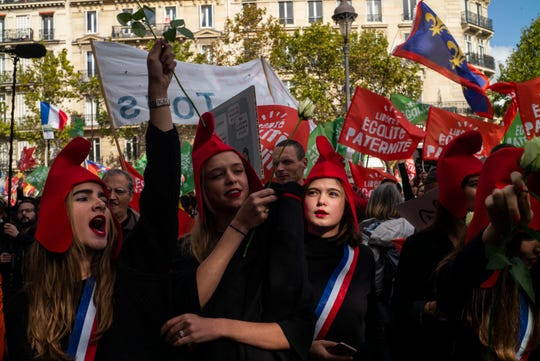 Conservative activists gather to protest in Paris, Sunday Oct. 6, 2019, against a French bill that would give lesbian couples and single women access to in vitro fertilization and related procedures. Traditional Catholic groups and far-right activists organized Sunday's protest, arguing that it deprives children of the right to a father.