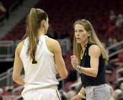 Michigan coach Kim Barnes Arico, right, has guided the Wolverines to seven consecutive 20-win seasons.