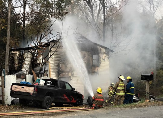 Firefighters battle flames Wednesday at a house in the Steuben County Town of Woodhull.