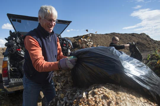 Phil Teague unloads bags of leaves for recycling at Hageman Earth Cycle this file photo from 2015.