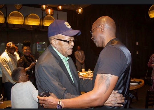 """William """"Coot"""" Ferrell Jr. (on the left) was the first black officer to retire after a 25-year career with the Fort Myers Police Department. He is pictured with his son, William Ferrell III, during an awards ceremony in 2019. The elder Ferrell died on Oct. 9 at the age of 90."""