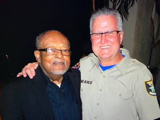 """William """"Coot"""" Ferrell Jr. (on the left) was the first black officer to retire after a 25-year career with the Fort Myers Police Department. He is pictured with Bill Weaver, a Lee County sheriff's office deputy. Ferrell Jr. and Weaver used to work in Dunbar together in the seventies. Ferrell Jr. died on Oct. 9 at the age of 90."""