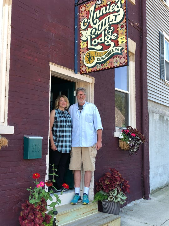 Ann Maloney outside her new downtown Kewaunee quilting shop, Annie's Quilt & Lodge, with her husband, Kevin.