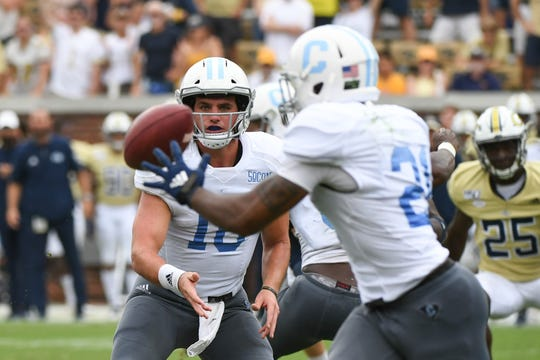 The Citadel's triple option on offense -- shown here as quarterback Brandon Rainey (16) pitches the ball to running back Nkem Njoku (28) -- can be a four-down challenges, Furman coach Clay Hendrix says.