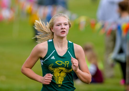 CMR's Kynsie Schmidt races to the finish line as the top girls finisher in the crosstown cross country meet at Anaconda Hills Golf Course on Tuesday.