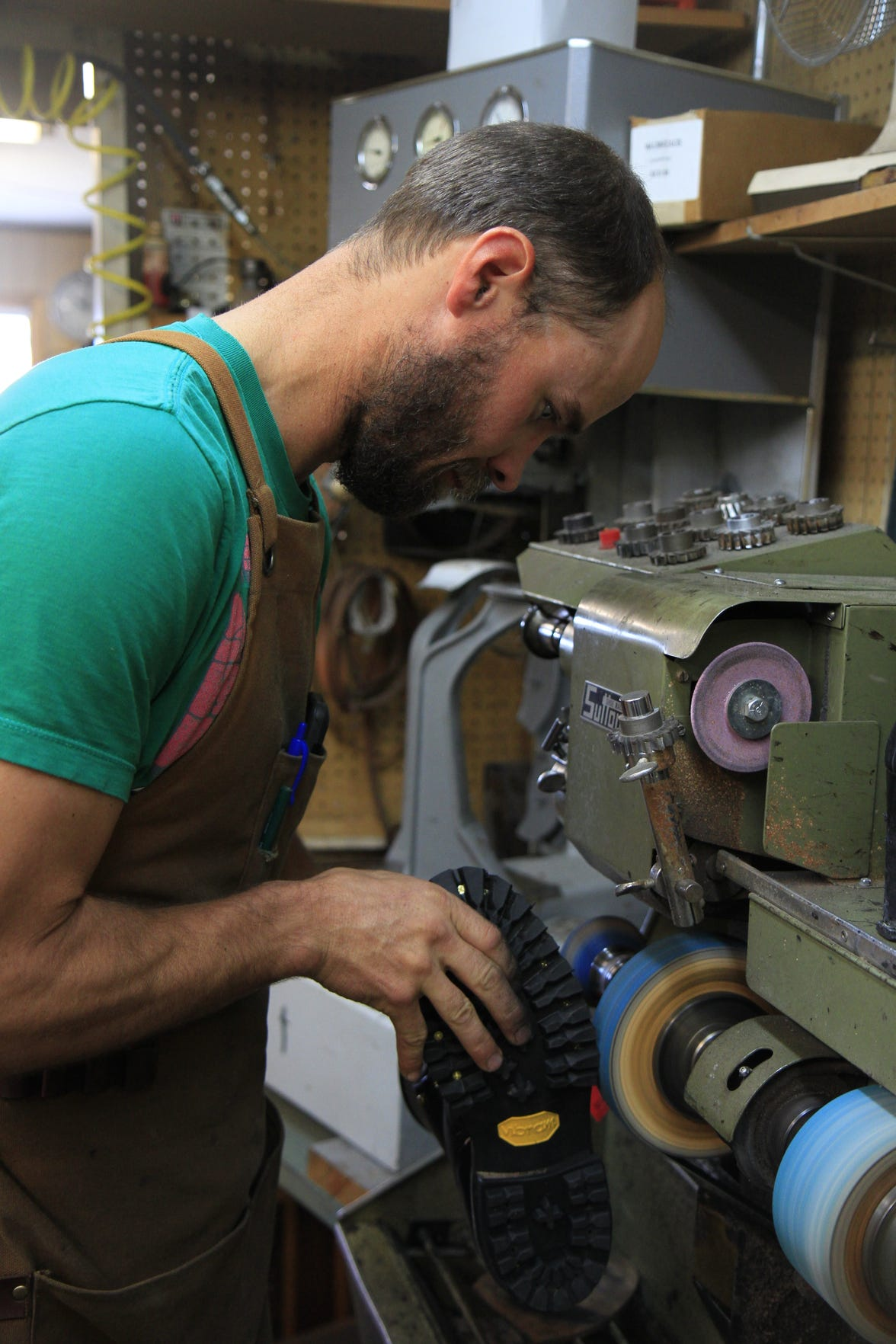 Tom Barrett repairing a shoe in his apprenticeship at Siller's Boot and Shoe Repair.