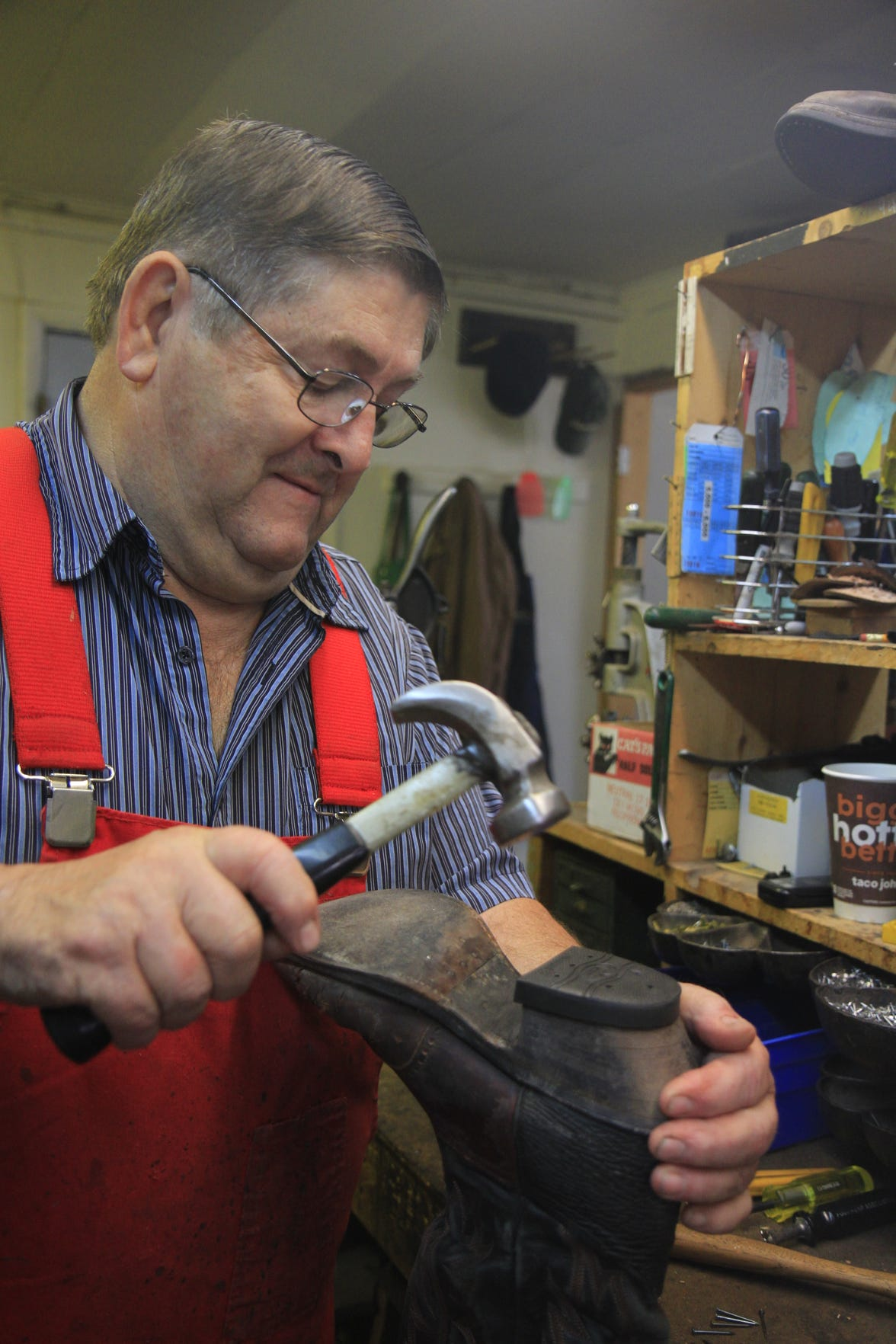 Dennis Siller working repairing a boot at Siller's Boot and Shoe Repair on October 3, 2019.