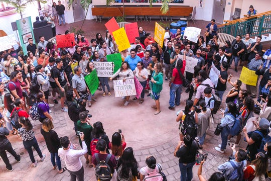 Students and other supporters express their opposition to a proposed increase in tuition rates during a protest at the University of Guam campus in Mangilao on Wednesday, Oct 16, 2019.
