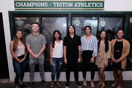 Triton athletes featured on the Champions of Triton Athletics wall include, from left: Elisha Benavente; Logan Hopkins; Ariya Cruz; Niah Siguenza; Jan-Nasia Travilla; Isla Quinata; and Sopheary Soun.