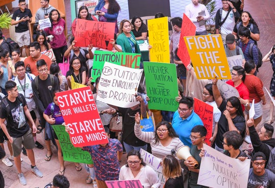 Students and other supporters gather in the center court of Jesus and Eugenia Leon Guerrero Business and Public Administration building to express their opposition to a proposed increase in tuition rates being considered at the University of Guam on Wednesday, Oct 16, 2019.