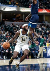 Indiana Pacers forward JaKarr Sampson (14) searches to pass the ball during the second half against the Minnesota Timberwolves, Tuesday, Oct. 15, 2019, Bankers Life Fieldhouse, Indianapolis. Timberwolves defeat Pacers 119-111 in preseason finale.