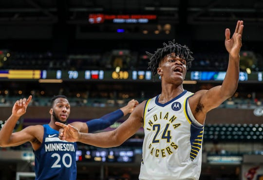 Indiana Pacers forward Alize Johnson (24) reacts to an out of bounds call with Minnesota Timberwolves guard Josh Okogie (20) during the second half against the Minnesota Timberwolves, Tuesday, Oct. 15, 2019, Bankers Life Fieldhouse, Indianapolis.