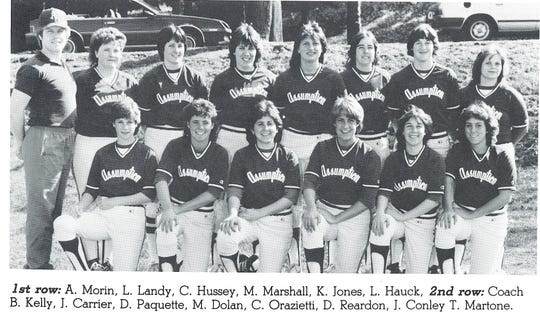 Brian Kelly (far left) with his Assumption College women's softball team in the mid-1980s