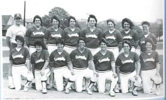 Brian Kelly (back row, far left) with the Assumption College women's softball team he coached as an assistant in 1983 and as head coach from 1984-87