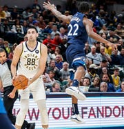 Indiana Pacers center Goga Bitadze (88) attempts a three-point shot while Minnesota Timberwolves forward Andrew Wiggins (22) jumps for a block during the second half, Tuesday, Oct. 15, 2019, Bankers Life Fieldhouse, Indianapolis. Timberwolves defeat Pacers 119-111 in preseason finale.