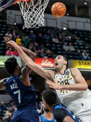 Indiana Pacers center Goga Bitadze (88) reaches for a layup against Minnesota Timberwolves forward Jordan Bell (7) during the second half against the Minnesota Timberwolves, Tuesday, Oct. 15, 2019, Bankers Life Fieldhouse, Indianapolis.