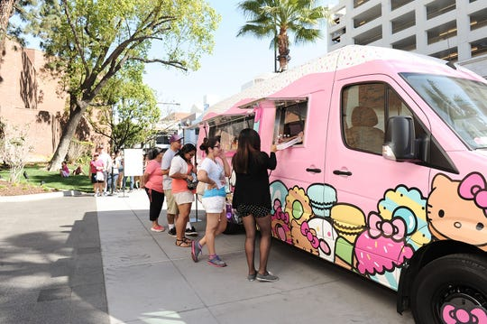 Fans line up to purchase food and collectibles from the Hello Kitty Cafe Truck.