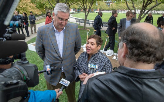 Gov. Eric Holcomb (left) and White River State Park Executive Director Carolene Mays-Medley, talk to media members after announcing a makeover of the Lawn at White River State Park in Indianapolis on Wednesday, Oct. 16, 2019. The rebuild will include a permanent stage and should be done in time for the 2020 summer concert season.