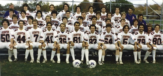 Brian Kelly (No. 53, third row, second from right) was a two-time captain as a linebacker at Assumption College in the early 1980s