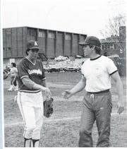 Brian Kelly (right) greets third baseman Helen Russell of the Assumption College women's softball team. Kelly was the Greyhounds' head coach from 1984-87 after serving as an assistant in 1983 under Rita Castagna.