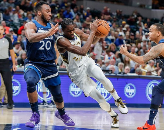Indiana Pacers forward Justin Holiday (8) pushes Minnesota Timberwolves guard Josh Okogie (20) for a layup during the second half against the Minnesota Timberwolves, Tuesday, Oct. 15, 2019, Bankers Life Fieldhouse, Indianapolis. Timberwolves defeat Pacers 119-111 in preseason finale.