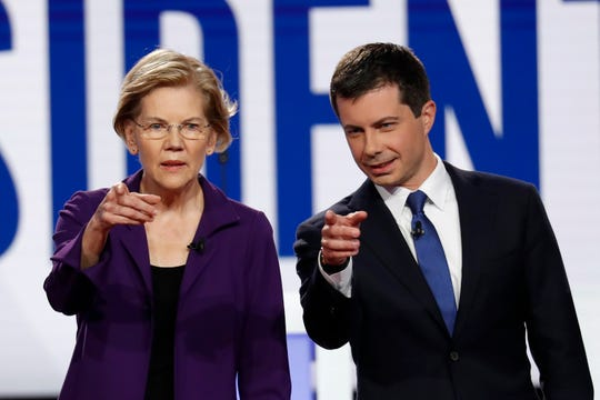 Democratic presidential candidate U.S. Sen. Elizabeth Warren, D-Mass., left, and South Bend Mayor Pete Buttigieg stand on stage before a Democratic presidential primary debate hosted by CNN/New York Times at Otterbein University on Oct. 15, 2019, in Westerville, Ohio.