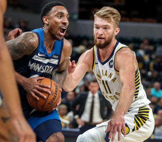 Minnesota Timberwolves guard Jeff Teague (0) pushes past Indiana Pacers forward Domantas Sabonis (11) for a layup during the first half, Tuesday, Oct. 15, 2019, Bankers Life Fieldhouse, Indianapolis. Timberwolves defeat Pacers 119-111 in preseason finale.