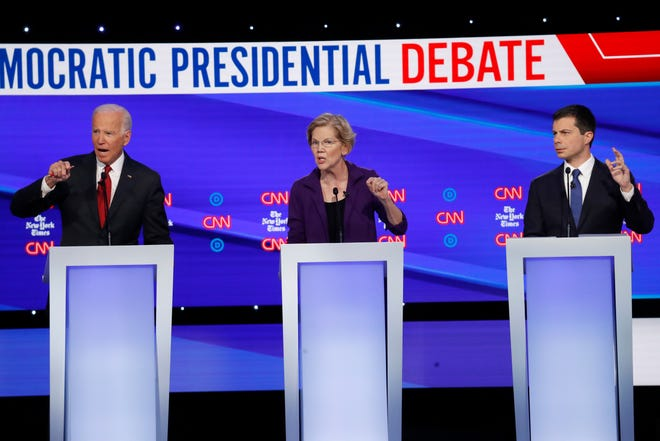 Democratic presidential candidate former Vice President Joe Biden, left, U.S. Sen. Elizabeth Warren, D-Mass., and South Bend Mayor Pete Buttigieg speak during a Democratic presidential primary debate hosted by CNN/New York Times at Otterbein University on Tuesday, Oct. 15, 2019, in Westerville, Ohio.