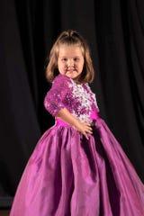 Kathryn Byrum strikes a pose in her purple dress.