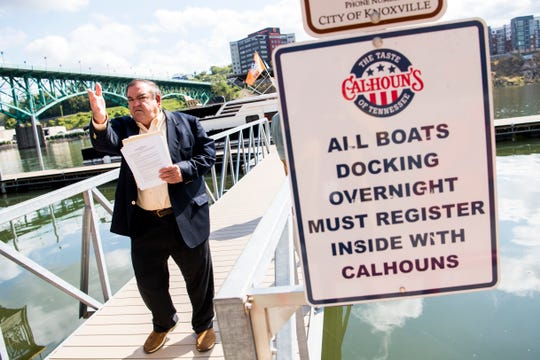 Knoxville restauranteur Mike Chase on the dock outside of Calhoun's, his restaurant, in downtown Knoxville on Wednesday, October 9, 2019.