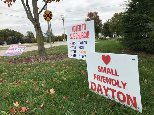 Yard signs aimed at the Dayton Town Council in an ongoing debate over growth are scattered across the town just east of Lafayette, ahead of the Nov. 5 municipal elections.
