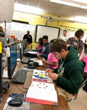 Acadiana High Business Academy students play a card game about competitive advantages and revenue streams Tuesday, Oct. 15.