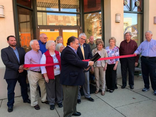 Ohio Sen. Tim Schaffer, R-Lancaster, reads a proclamation commemorating the Ohio Glass Museum's purchase of the building at 124 W. Main it had leased since 2006. Onlookers include the museum board members and Mayor David Scheffler on the far right.