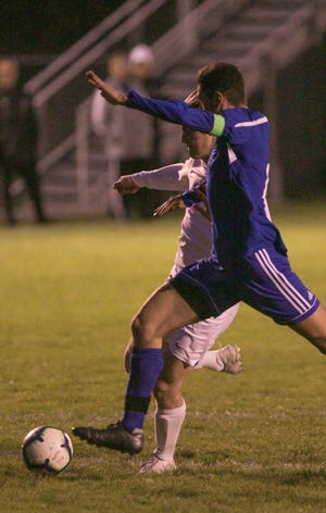 Max Reis winds up for Howell's only goal in a 3-1 overtime loss to Detroit Catholic Central on Tuesday, Oct. 15, 2019.